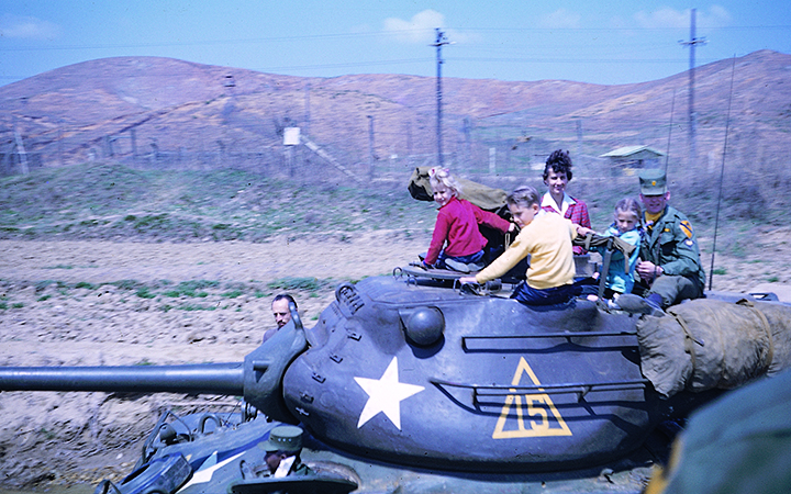 Early PFS students riding in a tank