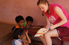 TCIS student reads to children in India