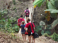 Students trekking to mountain village in the hills of Thailand