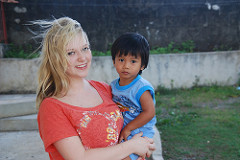 TCIS student holds a new friend at children's home in Manila