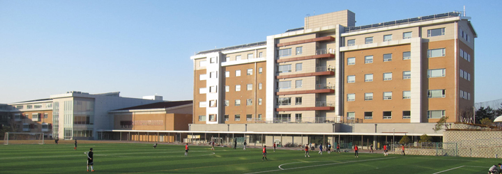 TCIS dormitory building overlooking the soccer field