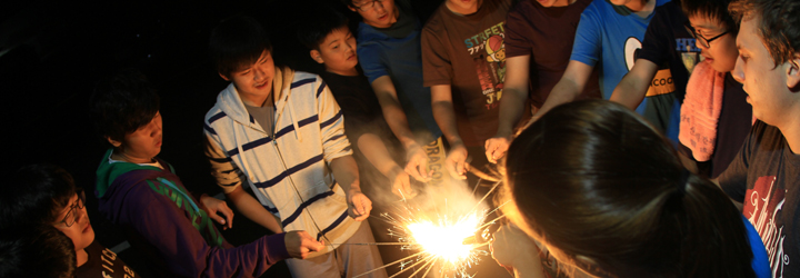 Residence students have a fun moment with sparklers