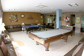 One dorm recreation area with pool table, table tennis, foosball, and lots of seating