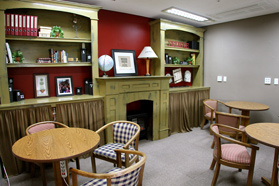 A quiet group study room in one of the dorm common areas, complete with seating and fireplace.